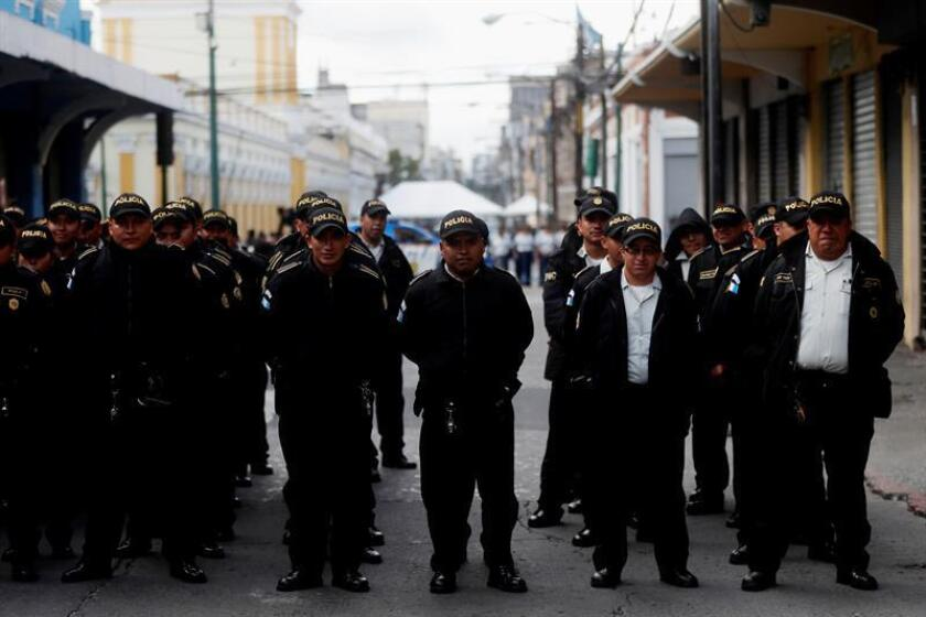 Photo showing Guatemalan police and security forces deployed near and around Congress in Guatemala City on Jan. 14, 2019, prior to the presentation of President Jimmy Morales' annual report to lawmakers. EFE-EPA/Esteban Biba
