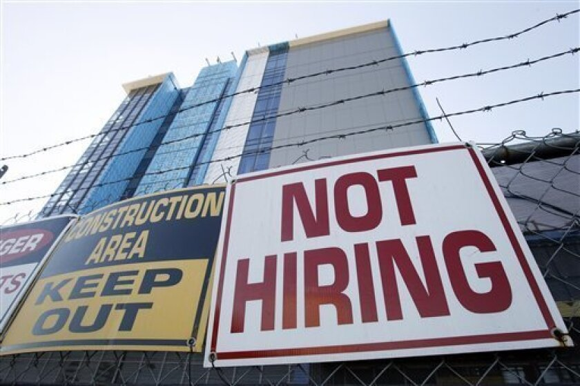 A survey of small-business owners shows a reluctance to hire despite an improved outlook for the economy. In this Nov. 4, 2010 photo, a sign turning away potential job-seekers is seen outside of a construction site in New Orleans.