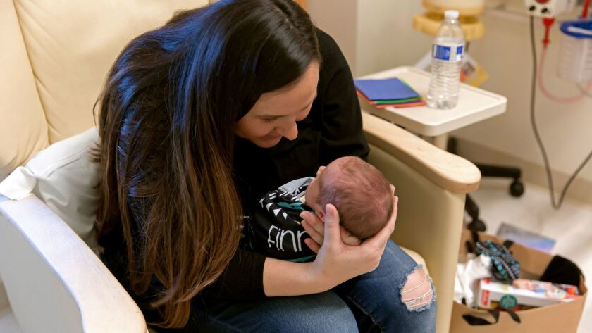 Briana Walker of Mission Viejo holds her son while he was hospitalized in the neonatal intensive car
