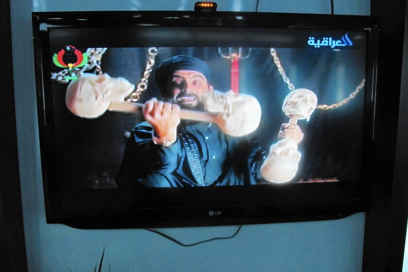 """An Iraqi actor portrays a character spoofing Islamic State leader Abu Bakr Baghdadi, shown lifting barbells made of human skulls, in the hit TV show """"State of Superstition."""""""