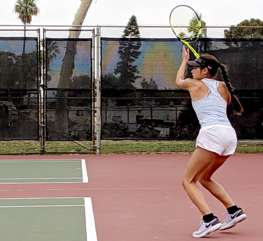 Mika Ikemori of Huntington Beach hits a forehand return in the first set of her girls' 16-and-unde