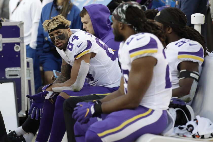 Minnesota Vikings tight end Irv Smith (84) sits on the bench with teammates during the second half of an NFL divisional playoff football game against the San Francisco 49ers, Saturday, Jan. 11, 2020, in Santa Clara, Calif. The 49ers won 27-10. (AP Photo/Marcio Jose Sanchez)