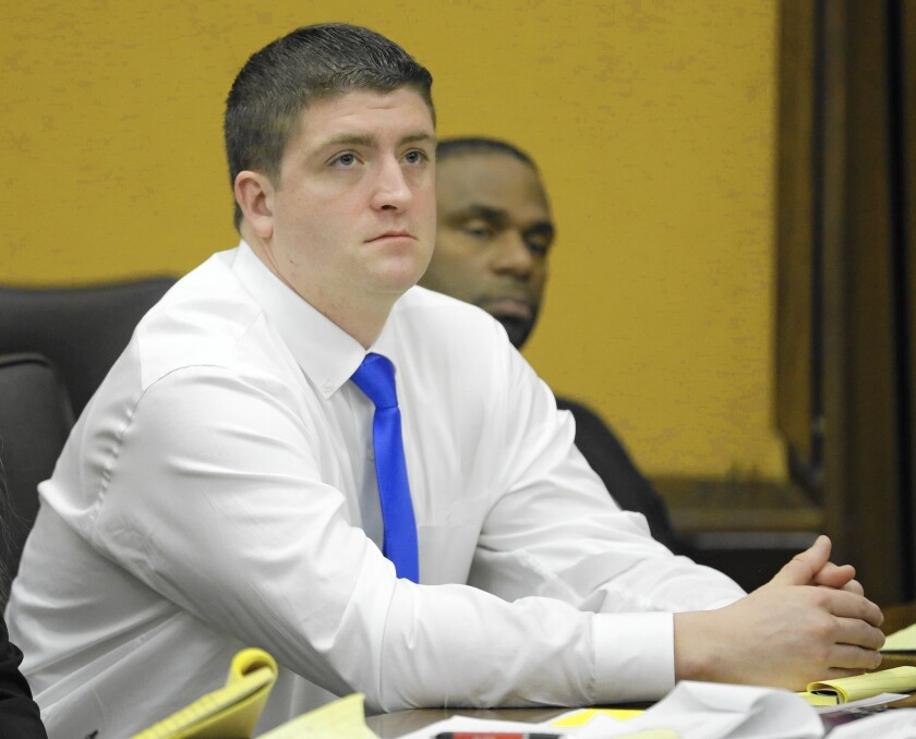 Cleveland Police Officer Michael Brelo listens to opening arguments in his manslaughter trial.