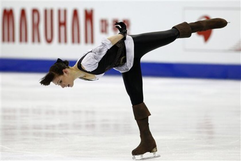 Alena Leonova of Russia performs during her Women's short program at the ISU 2012 World Figure Skating Championships in Nice, southern France, Thursday, March 29, 2012. (AP Photo/ Francois Mori)