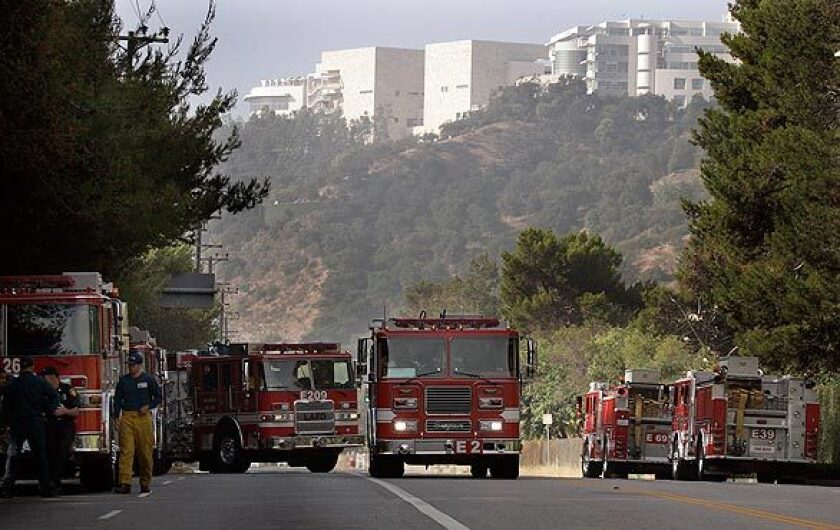 Fire trucks at a staging area on Sepulveda Boulevard near the Getty Center entrance.