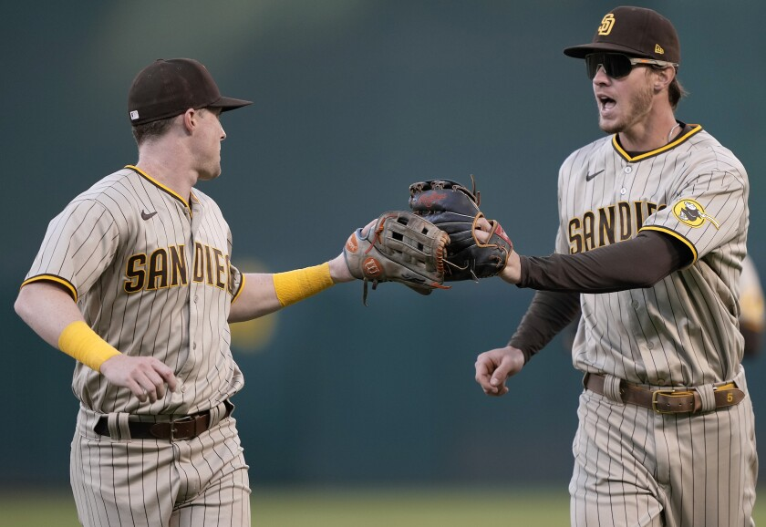 The Padres' Jake Cronenworth celebrates with Wil Myers after Myers