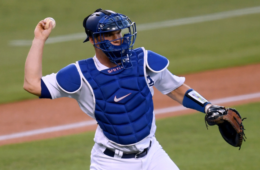 Dodgers catcher Will Smith throws during a game against the Padres.