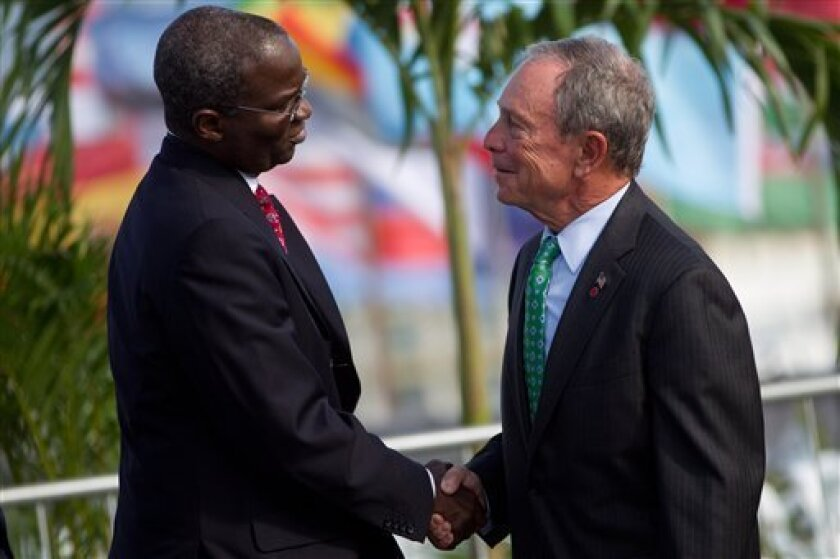 New York mayor Michael R. Bloomberg, right, and Babatunde Fashola of Lagos, shake hands during the UN Conference on Sustainable Development, or Rio+20, in Rio de Janeiro, Brazil, Tuesday, June 19, 2012. While squabbling between rich and poor countries threatens to derail the Earth summit, the world