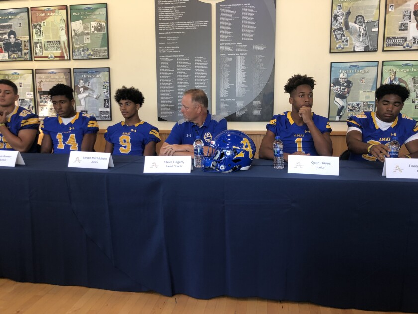 Bishop Amat players and coaches answer questions at media day.