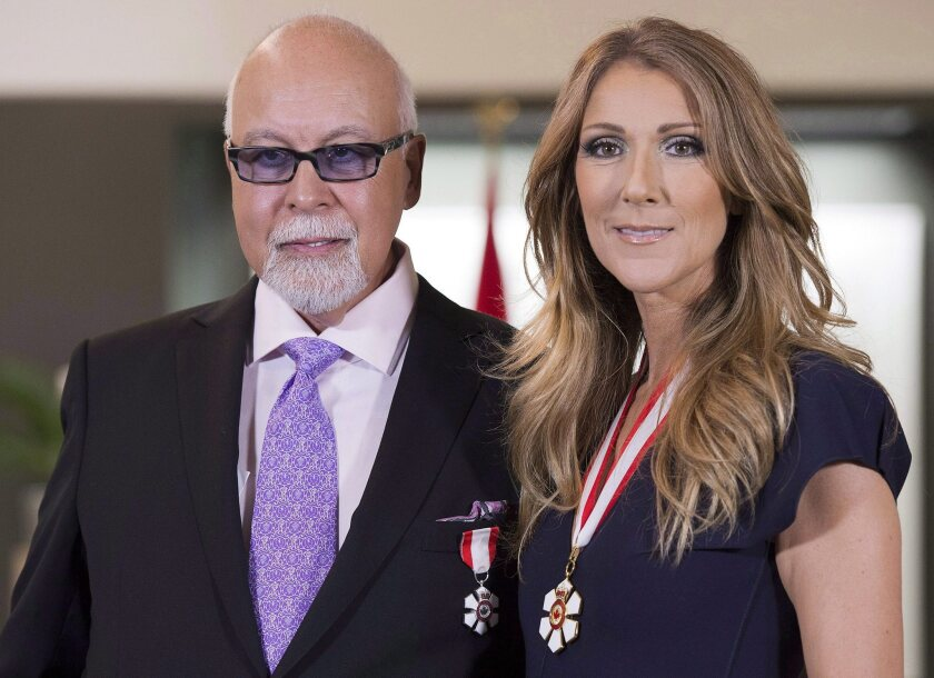 This July 26, 2013 file photo shows Rene Angelil and his wife, Canadian music star Celine Dion, posing for photos after being decorated with the Order of Canada in Quebec City. For the first time in her lengthy music career, Dion will have a manager other than Angelil.