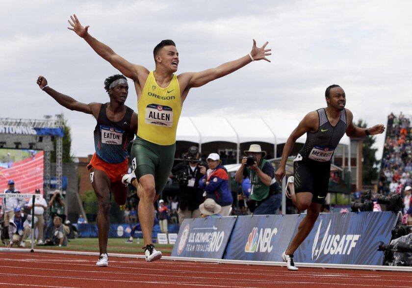 Devon Allen celebrates his win in the finals of the men's 110-meter hurdles at the U.S. Olympic Track and Field Trials, Saturday, July 9, 2016, in Eugene Ore. (AP Photo/Marcio Jose Sanchez)