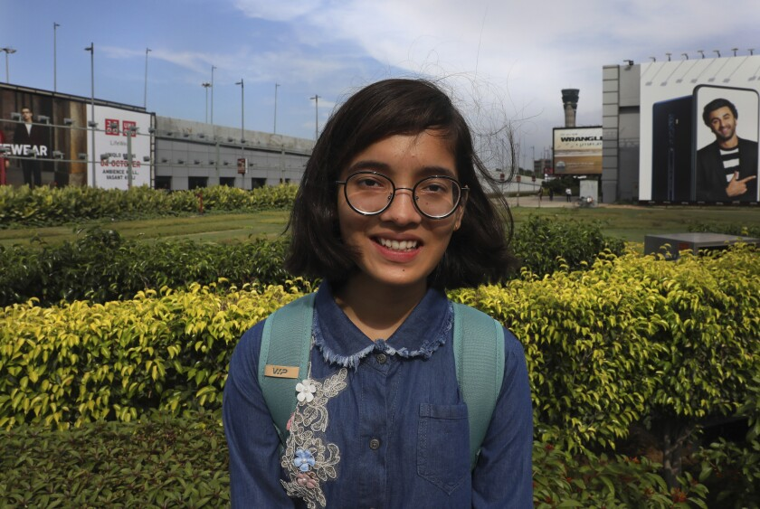 Indian child climate activist Ridhima Pandey, 11, poses for photographs upon her arrival from New York at the Indira Gandhi International airport, in New Delhi, India, Thursday, Sept. 26, 2019. Ridhima returned from her trip to the United Nations General Assembly, where she helped file a lawsuit, with children from around the world, against five countries for not tackling climate change. Pandey, from the northern state of Uttarakhand, previously sued the Indian government in 2017 for its inaction on the climate. (AP Photo/Manish Swarup)