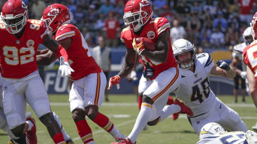 CARSON, CA, SUNDAY, SEPTEMBER 9, 2018 - Chiefs receiver Tyreek Hill leaps over defenders on his wa