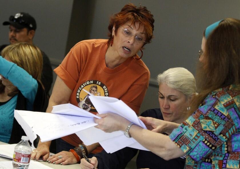 Lisa Karahalios helps tally ballots for an internal union ballot measure in 2013.