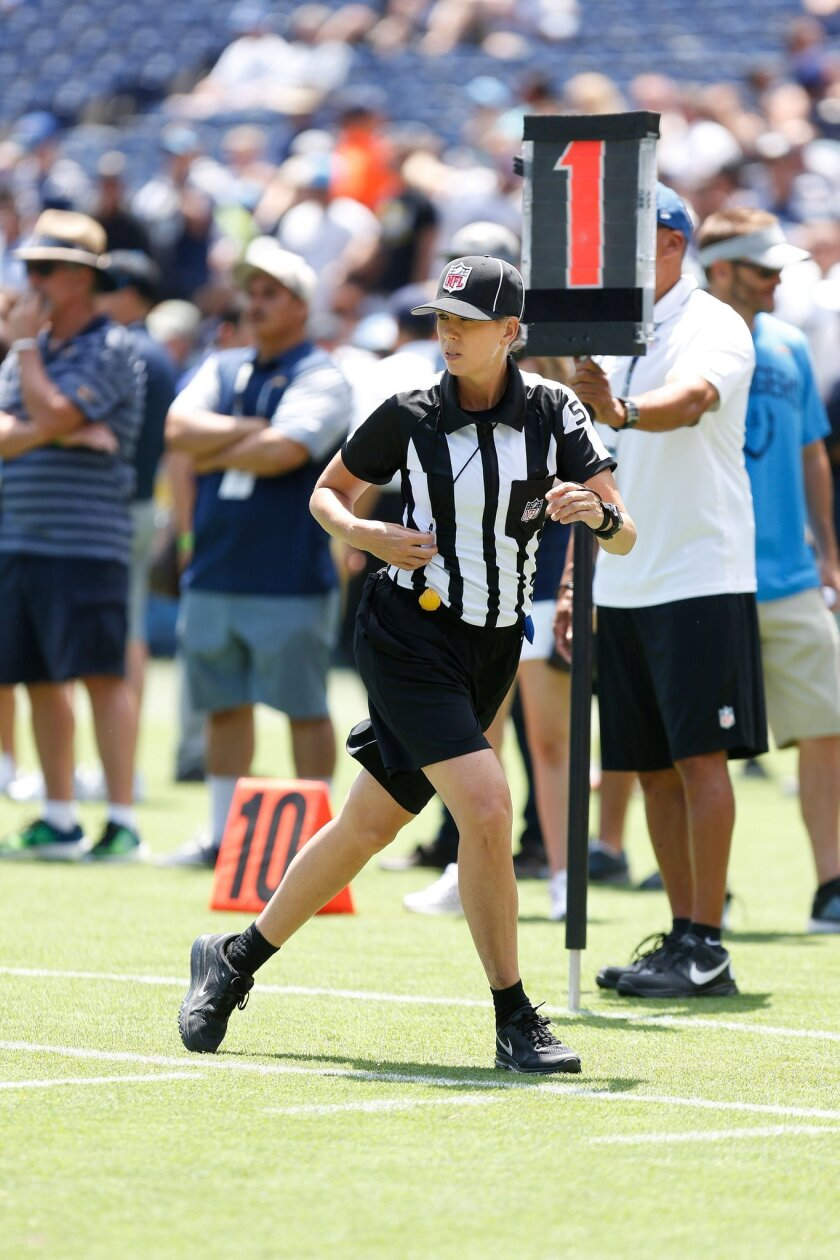 NFL referee Sarah Thomas runs with a play during the Chargers practice at Qualcomm Stadium.