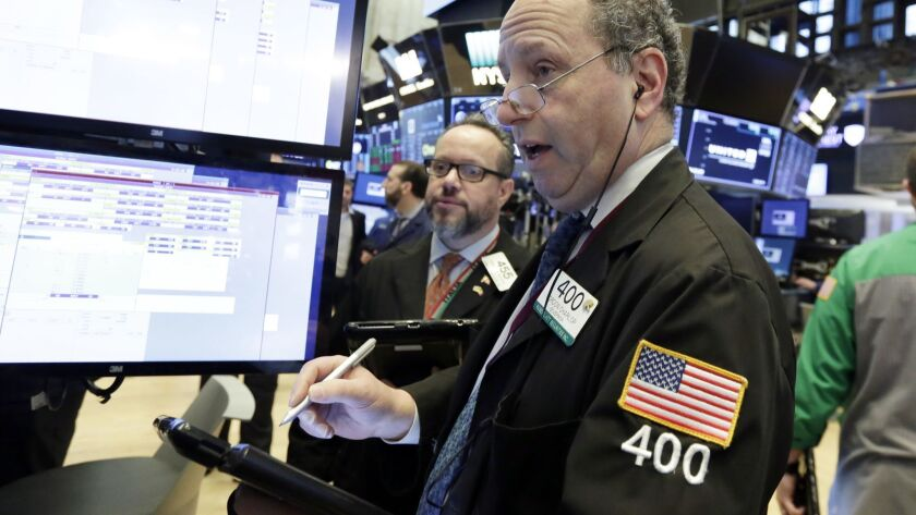 Traders Gordon Charlop, right, and Robert Arciero work on the floor of the New York Stock Exchange on Wednesday,