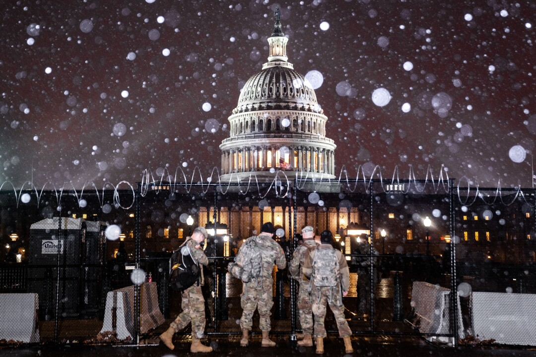 Snow falls over the U.S. Capitol grounds