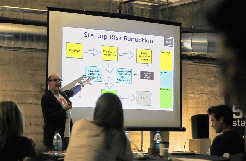 Dave McClure, founding member of 500 Startups, gives a presentation at a San Francisco event in April.