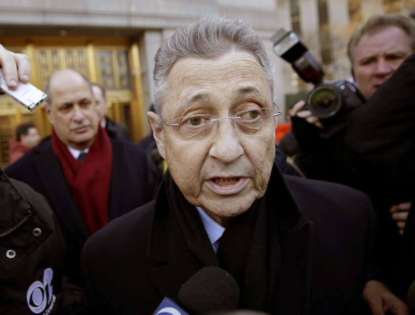 FILE- In this Jan. 22, 2015 file photo, New York State Assembly Speaker Sheldon Silver is surrounded by media as he leaves a federal courthouse in New York. Silver was indicted Thursday, Feb. 19, 2015 on three charges after his January arrest in a federal bribery case: honest services mail fraud, honest services wire fraud and extortion under the color of his official duties. (AP Photo/Seth Wenig, File)