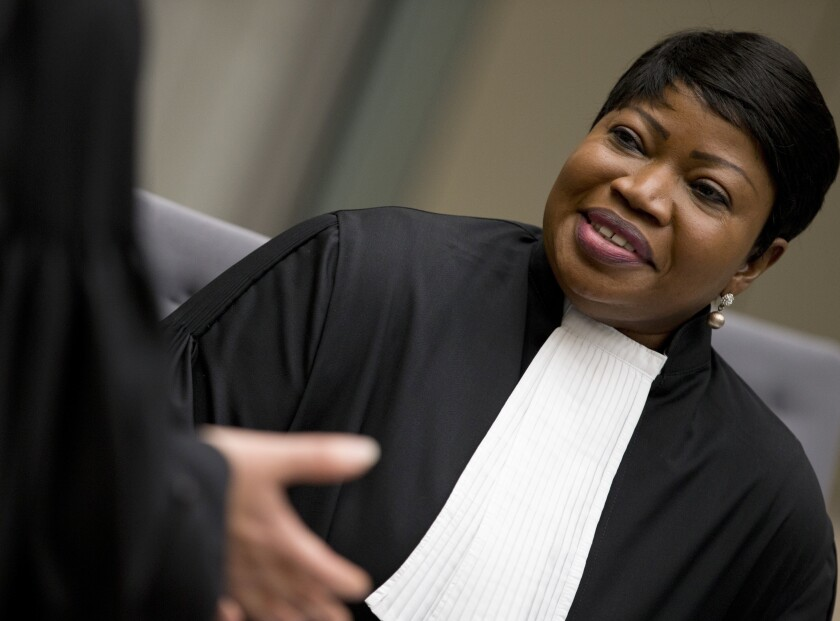 FILE- In this Wednesday, April 4, 2018 file photo, chief prosecutor Fatou Bensouda waits at the International Criminal Court in The Hague, Netherlands. The outgoing prosecutor of the International Criminal Court hit out Monday at sanctions slapped on her by the Trump Adminstration in her last speech to an annual gathering of the court's member states before she leaves office next year. (AP Photo/Peter Dejong, FILE)