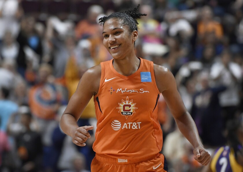 Connecticut Sun's Alyssa Thomas smiles after a basket during the second half of a WNBA basketball playoff game against the Los Angeles Sparks, Tuesday, Sept. 17, 2019, in Uncasville, Conn. (AP Photo/Jessica Hill)