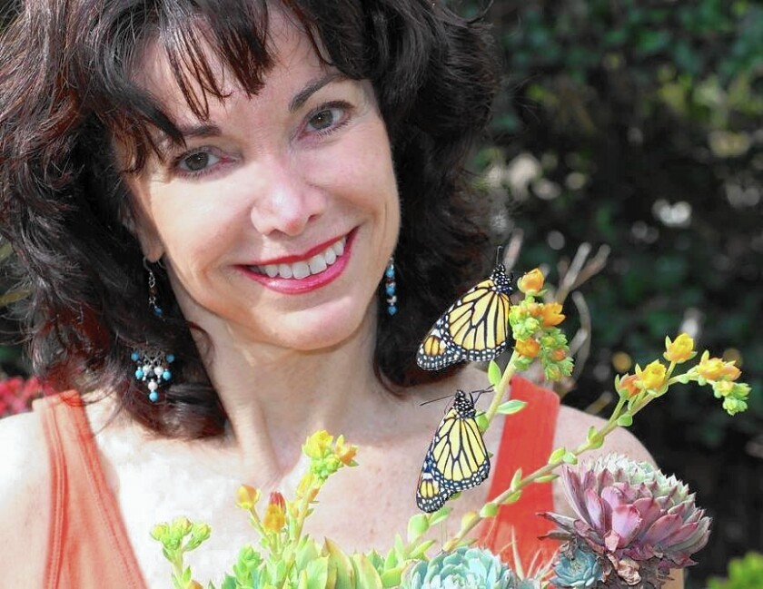Susie Vanderlip, a monarch butterfly expert, spoke Saturday at Coastkeeper Garden in Orange about how to attract butterflies into the yard.