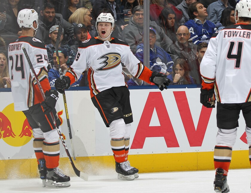 The Ducks' Max Jones, middle, celebrates his short-handed goal in the third period Feb. 7, 2020.