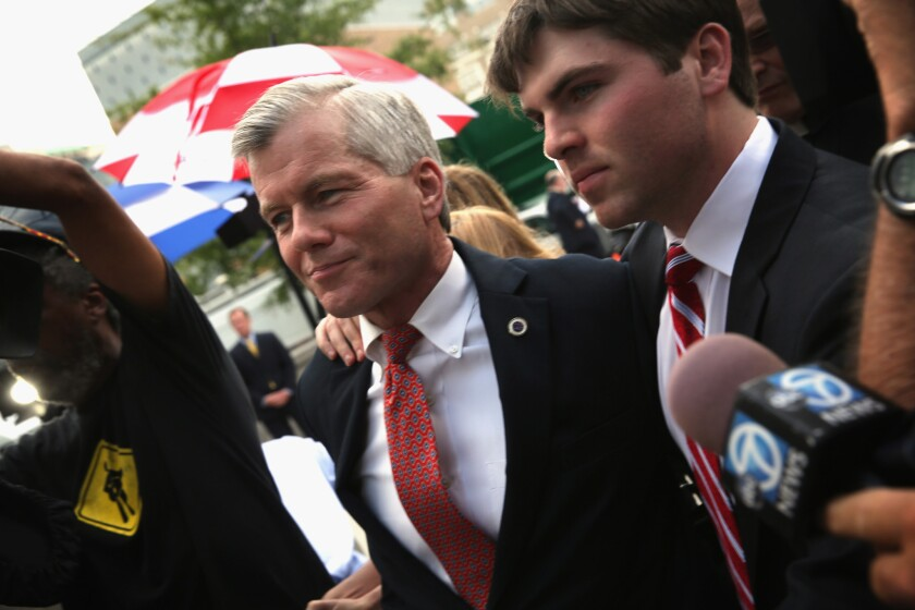 Former Virginia Gov. Bob McDonnell, shown with son Bobby in 2014, was convicted that year of 11 counts of corruption and sentenced to two years in prison. The Supreme Court has agreed to hear his appeal.