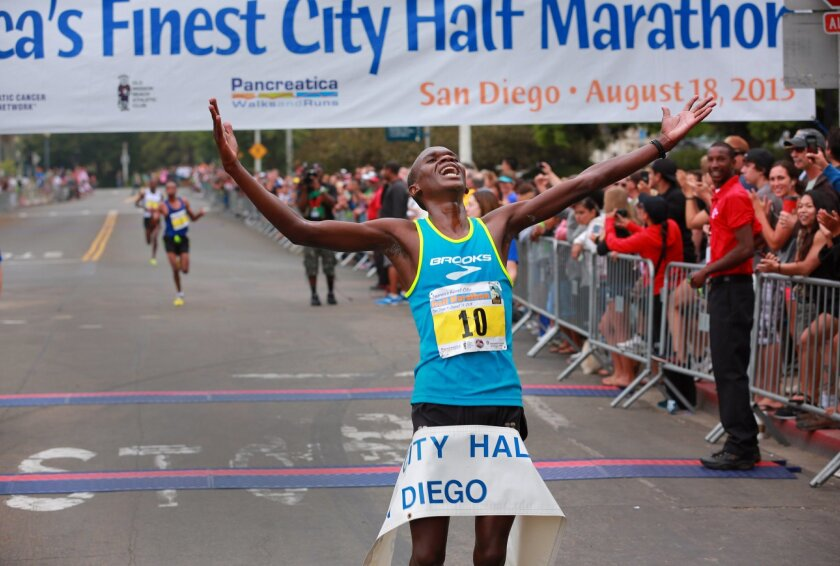 Nelson Oyugi of Kenya won the AFC Half Marathon Sunday. The running of the 36th annual America's Finest City half marathon and 5K saw a field of 10,000 runners enjoying cool, overcast conditions for the race that wound its way from the Cabrillo National Monument along Harbor Drive, through downtown and over the bridge into Balboa Park to finish in front of the Hall of Champions. All three male finishers in the AFC Half ran times that beat the existing course record. Participants came from 14 countries and 45 different states in the U.S. to run in both races.