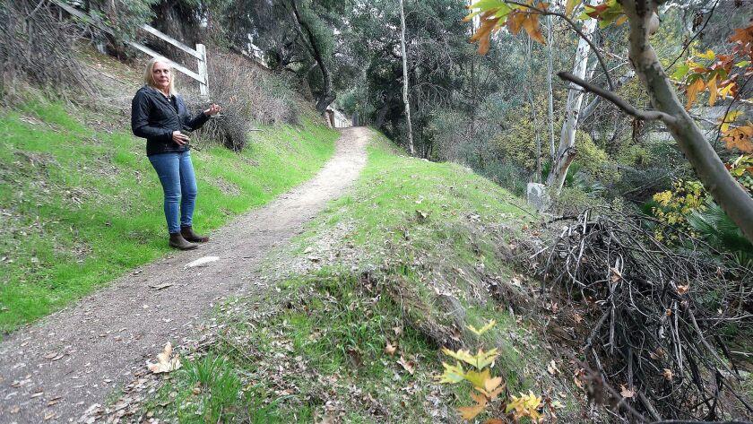 Caroline Craven, of La Canada Flintridge, stands near an area of the Flint Canyon Trail that is erod