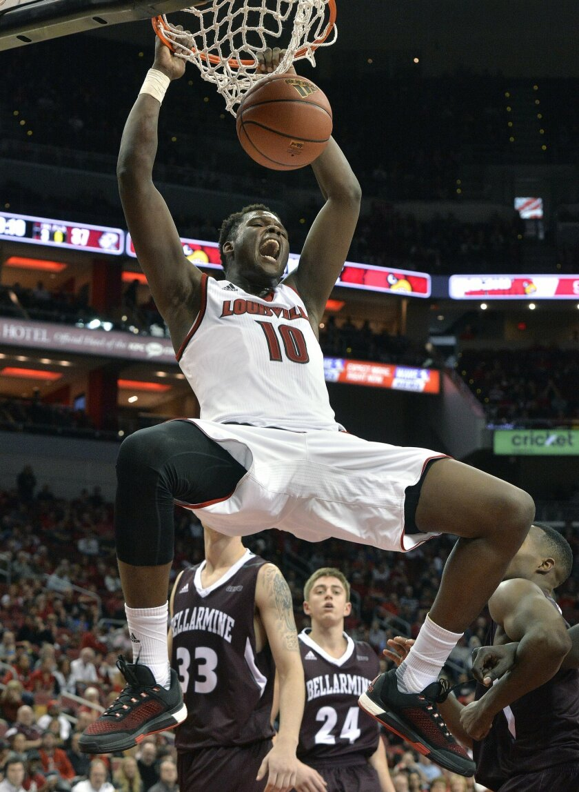 Louisville's Jaylen Johnson dunks for two of his game high 14 points during an NCAA college basketball game against Bellarmine, Sunday, Nov. 1, 2015, in Louisville, Ky. Louisville won 71-55. (AP Photo/Timothy D. Easley)