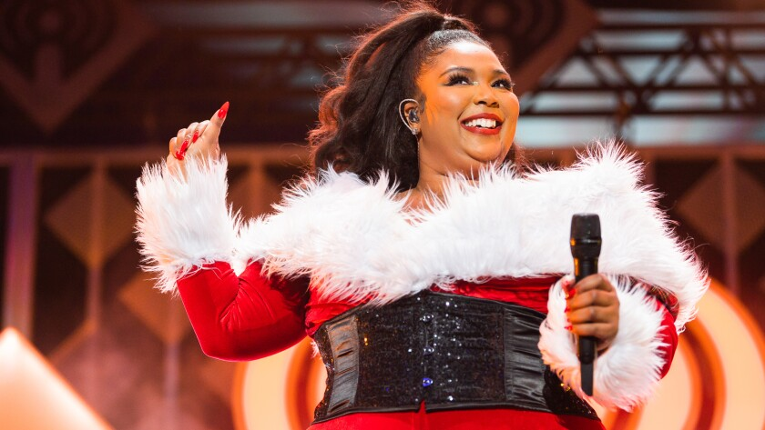 "Lizzo performs in the holiday special ""iHeartRadio Jingle Ball 2019"" on The CW."