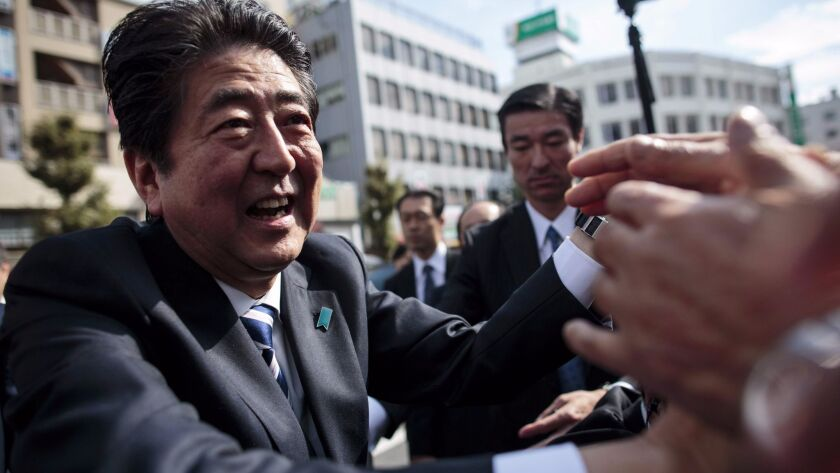 Japanese Prime Minister Shinzo Abe greets supporters at a campaign appearance Wednesday in Saitama.
