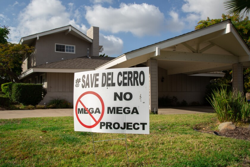 Some Del Cerro residents put out lawn signs opposing a 900-seat new church