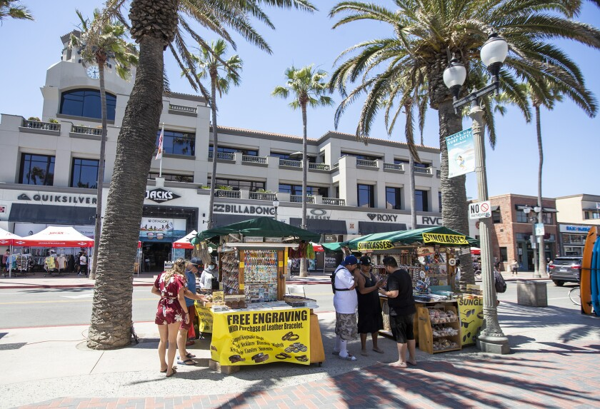 Things were back to normal in Huntington Beach on Monday after crowds gathered on the weekend.