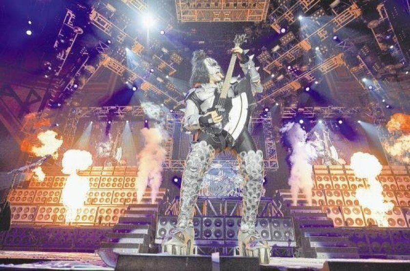 Have tongue, will travel: Kiss (with bassist Gene Simmons, above) brings its latest tour to town — at the same arena that hosted the band's 2000 farewell tour.