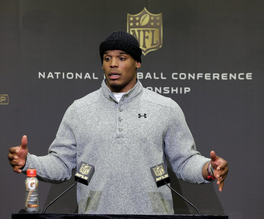 Carolina Panthers quarterback Cam Newton speaks to the media during a news conference in advance of the NFC Championship game against the Arizona Cardinals in Charlotte, N.C., Wednesday, Jan. 20, 2016. (AP Photo/Chuck Burton)