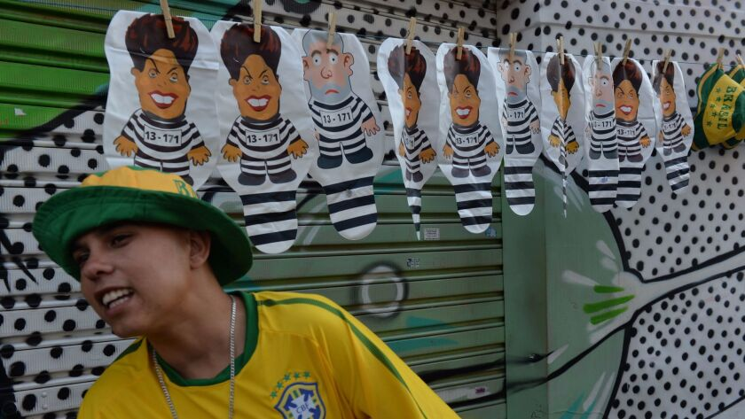 Balloons depicting two former Brazilian presidents, Dilma Rousseff and Luiz Inacio Lula da Silva, are popular items at protests throughout the country. This vendor sells them in Sao Paulo.