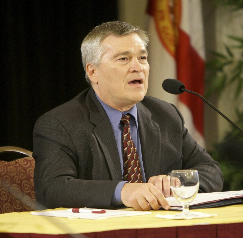 FILE - In this Dec. 8, 2009, file photo, Dr. Eric Barron, candidate for Florida State University President, answers questions from the Florida State University Board of Trustees, in Tallahassee, Fla. Barron, a former professor and dean at Penn State University and president of Florida State University, was chosen Monday , Feb. 17, 2014, to lead Pennsylvania's largest university as it continues grappling with fallout from the Jerry Sandusky scandal(AP Photo/Phil Coale, File)