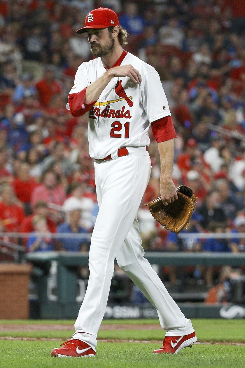 St. Louis Cardinals relief pitcher Andrew Miller walks toward the dugout after being relieved from the mound during the seventh inning of a baseball game against the Chicago Cubs, Friday, Sept. 27, 2019, in St. Louis. (AP Photo/Scott Kane)