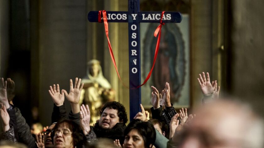 Catholics worship at the San Mateo cathedral in Osorno, Chile, on June 17, 2018.