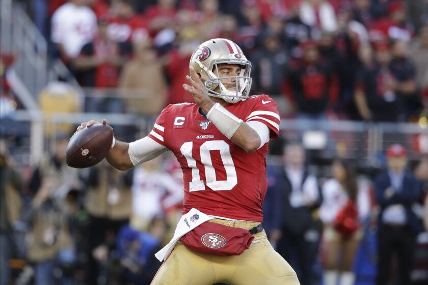 Quarterback Jimmy Garoppolo (10) looks to pass against the Vikings during the first half of an NFL divisional playoff game Jan. 11 at Levi's Stadium.