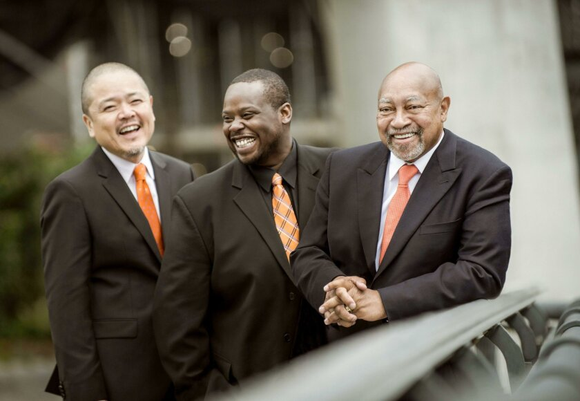 The Kenny Barron Trio is led by its piano-playing namesake (right).