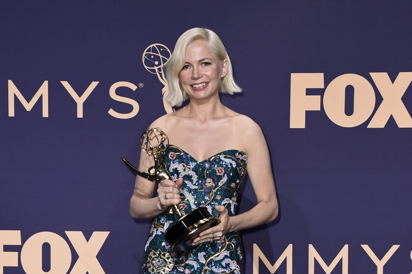 "Michelle Williams poses in the press room with the award for outstanding lead actress in a limited series or movie for ""Fosse/Verdon"" at the 71st Primetime Emmy Awards on Sunday, Sept. 22, 2019, at the Microsoft Theater in Los Angeles. (Photo by Jordan Strauss/Invision/AP)"