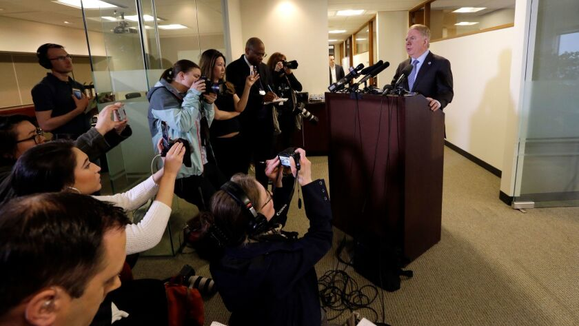 Seattle Mayor Ed Murray reads a statement to members of the media on April 7.