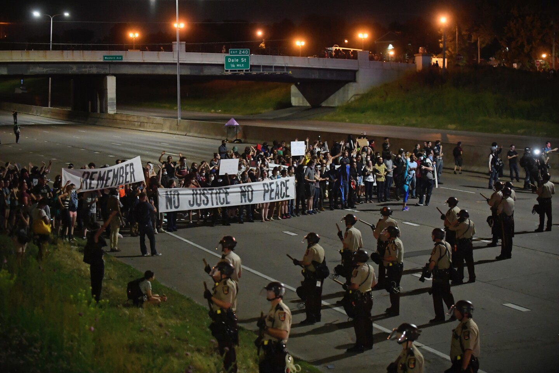 Supporters of Philando Castile block I-94 at Dale Avenue in St. Paul, Minn., after the verdict.