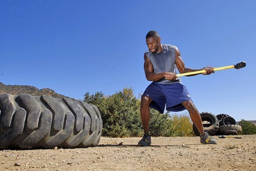 As part of his workout, Cromartie gets to repeatedly punish the tire that repeatedly punishes him.