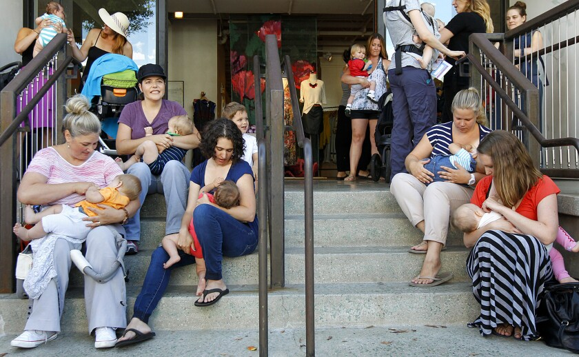 "A group of mothers breastfeed their children on the steps of retailer Anthropologie during a ""nurse-in"" in Beverly Hills on Aug. 20, 2014, after a mom was asked to nurse her 6-week old son in a bathroom at the store."