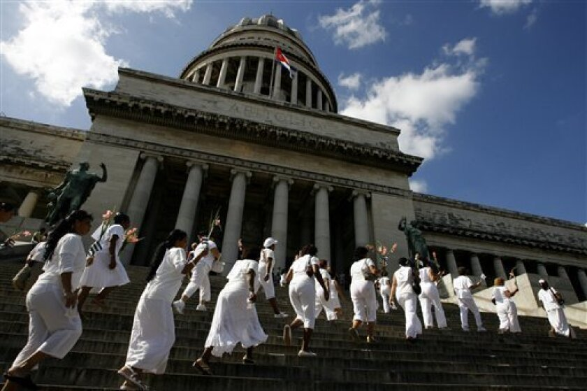 Members of Ladies in White movement march during the Human Rights Day in front of the Capitol building in Havana, Wednesday, Dec. 10, 2008. Ladies in White is a Cuban opposition movement integrated by relatives of jailed dissidents. (AP Photo/Javier Galeano)