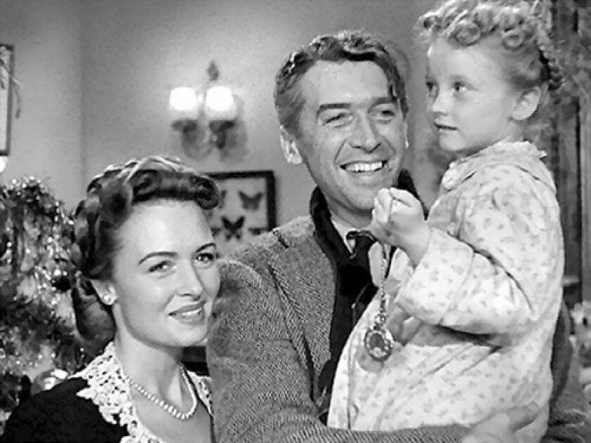 """Donna Reed, left, James Stewart and Karolyn Grimes in """"It's a Wonderful Life"""" (1946)"""